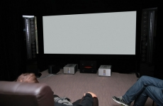 People in home cinema